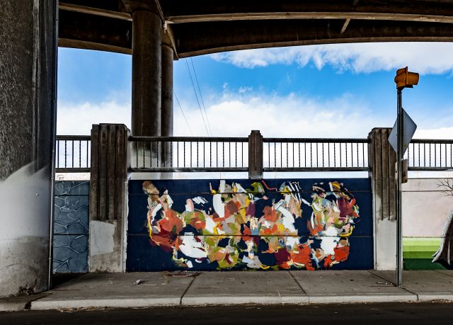 Untitled (abstract multi-colored mural on navy blue field)