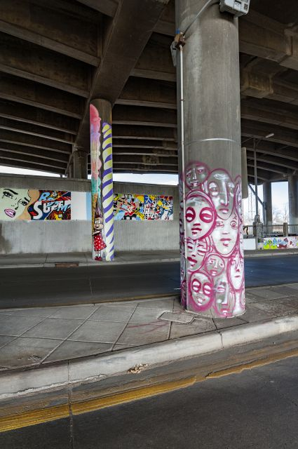 Untitled (concrete columns – pink faces, blue and green candle, bunny with ice cream cone)