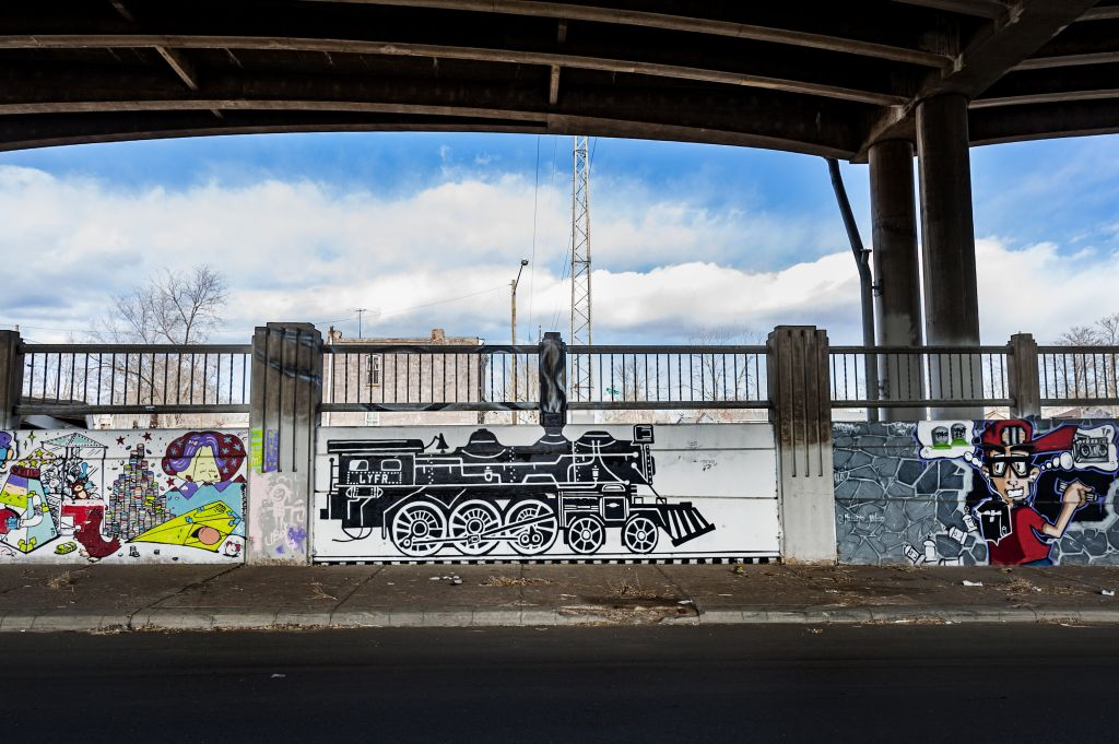 Go to the Untitled (two murals - black and white locomotive engine, boy holding a boom box) page
