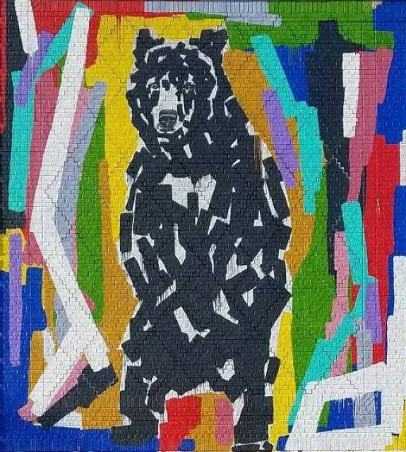 Untitled (black bear surrounded by abstract colors).
