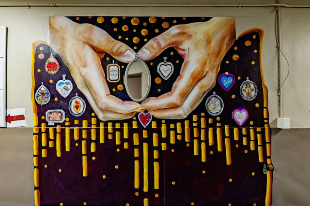 Untitled (hands opening up a locket holding a mirror)