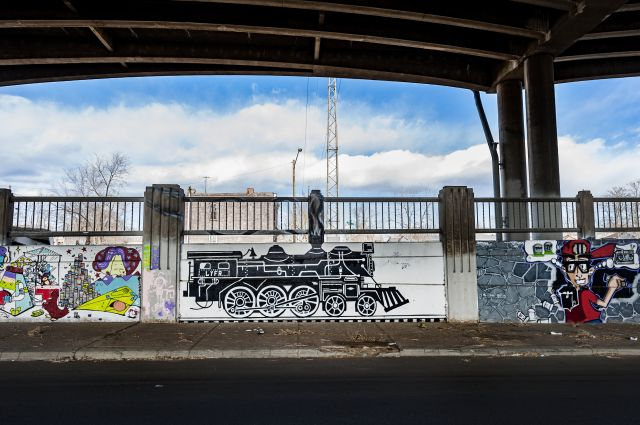 Untitled (two murals – black and white locomotive engine, boy holding a boom box)
