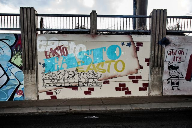"""Untitled (mural with the word """"Easto"""" written in different colors and variation)"""