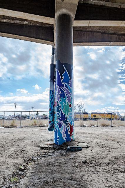 Untitled (blue stylized graffiti-style artwork on two columns)