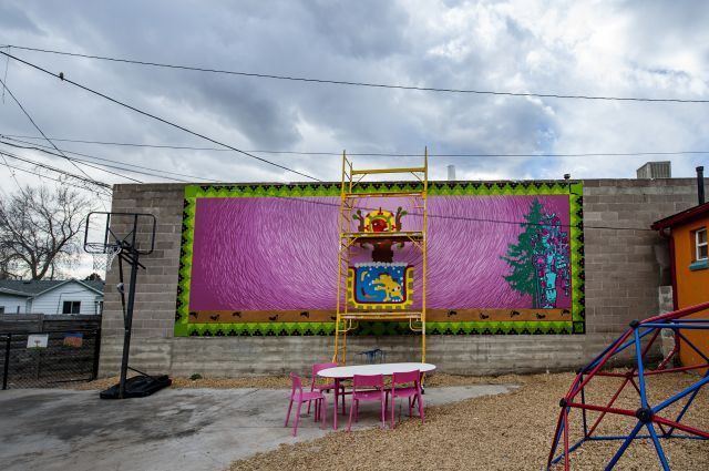 Untitled (fuchsia-colored mural with Aztec images)
