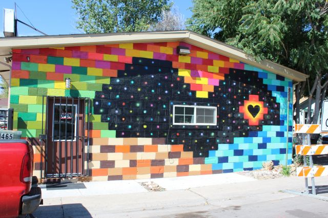 Untitled (black heart amidst colorful bricks)