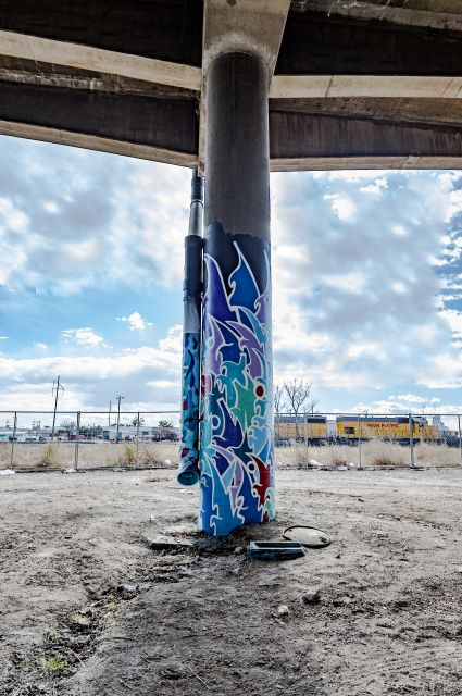 Untitled (blue stylized graffiti-style artwork on two columns)